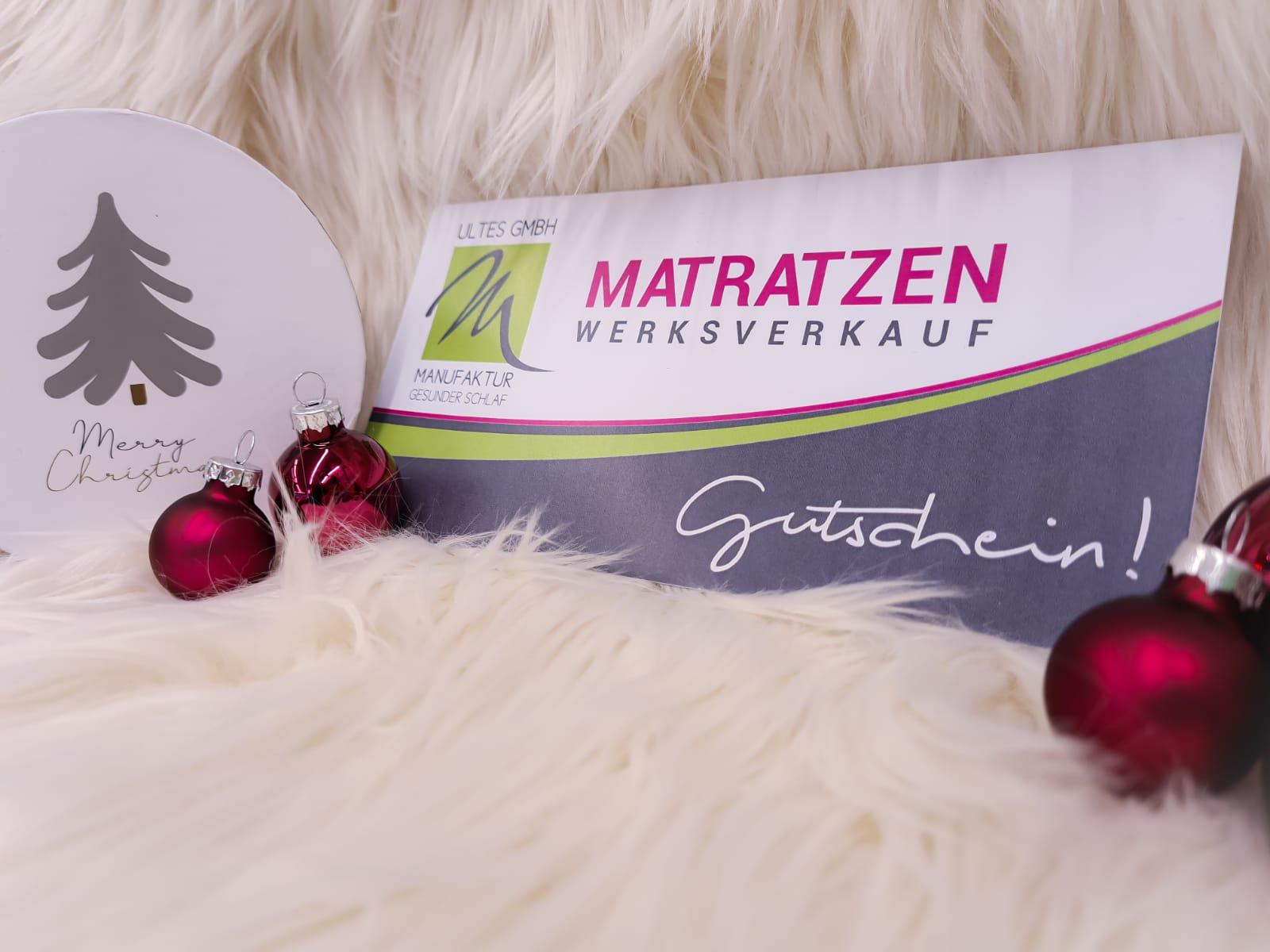Ein Gutschein der Firma Ultes weihnachtlich dekoriert
